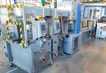 Picture of Ferag Two lines of Ferag SSP Strappers with an in-line AFFELDT SA20 automatic wrapping machine.